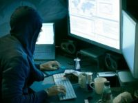 Unul dintre cei mai vanati hackeri din lume, prins in Romania si trimis in SUA