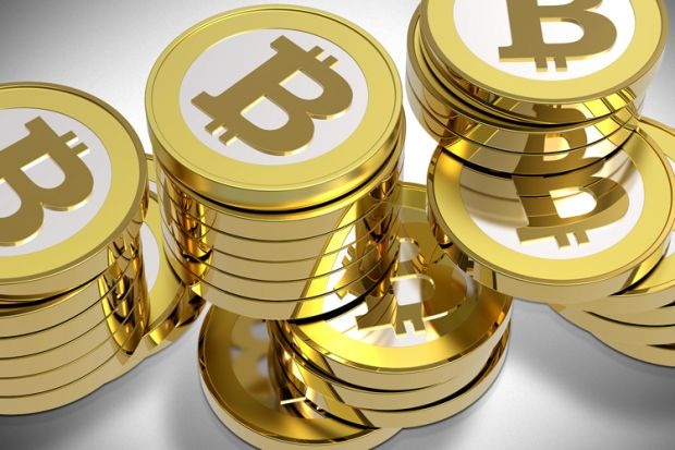 Bitcoin, moneda virtuala a internautilor, creste spectaculos